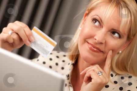 Beautiful Woman Using Laptop Holding Her Credit Card stock photo, Beautiful Woman on Her Laptop Holding Her Credit Card. by Andy Dean