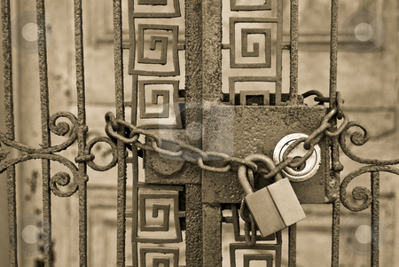 Locked Up stock photo, A gate under lock and chain outside a foreclosed home. by ALEX CHOW