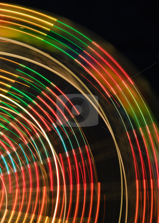 Colorful Contours of a Ferris Wheel stock photo, The colorful contours of a spinning ferris wheel at night. by ALEX CHOW
