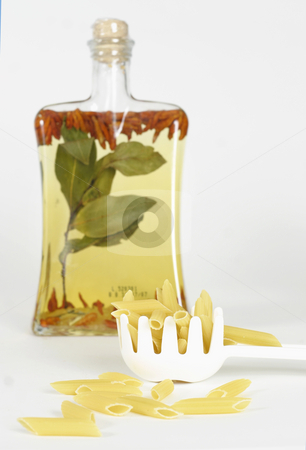 Infused oil and pasta stock photo, Infused olive oil and pasta shells by Leah-Anne Thompson