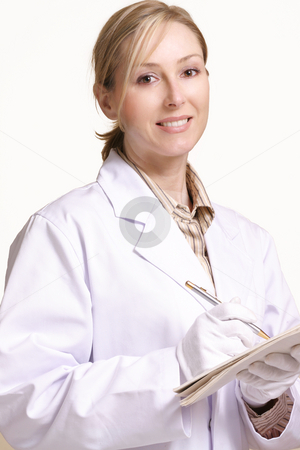 Smiling Healthcare Female stock photo, Smiling female at work by Leah-Anne Thompson