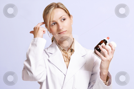 Confused about medicines stock photo, Considering natural or alternative medicines or contemplating the right cure. by Leah-Anne Thompson