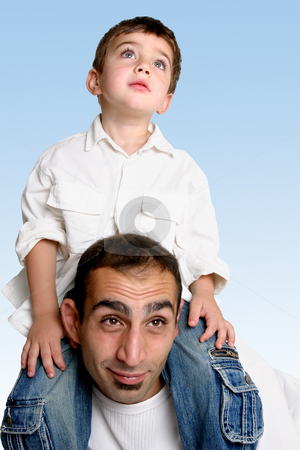 Child sitting on father's shoulders stock photo, Sky is the limit....   A child sits atop his father's shoulders looking skyward. by Leah-Anne Thompson