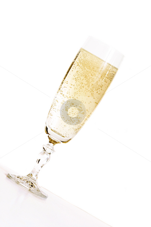 Champagne (angled) stock photo, Celebration.  An angled glass of champagne in a champagne flute glass. by Leah-Anne Thompson