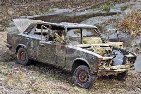 The car of the Russian gangster stock photo, The car of the Russian gangster killed in firing. To the car have set fire and have left on a scene of crime. by Aleksandr Volokov