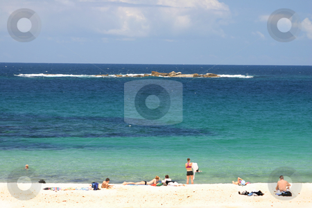 Summer Vacation stock photo, White sandy beach with sunbathers and swimmersShot with added contrast and polarizer has an almost 3d  effect..  Wedding Cake Is. in the distance. by Leah-Anne Thompson
