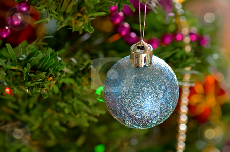 Blue christmas bulbs stock photo, Some christmas balls decorated on a tree by Tito Wong