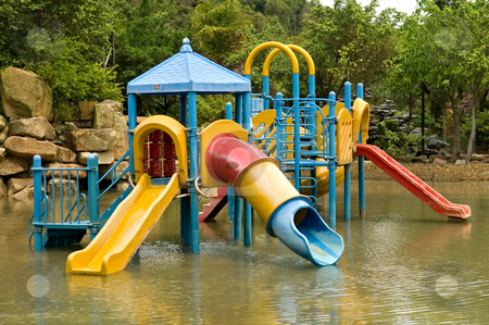 Colorful water playground stock photo, A colorful children playground on water park by Tito Wong