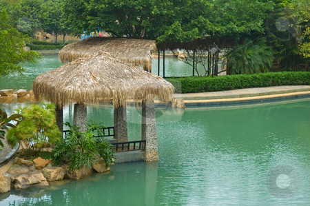 Pavilion with thatch roof stock photo, The pavilion with thatch roof beside swimming pool by Tito Wong