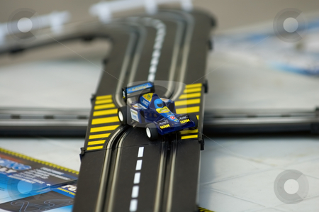 Car racing  stock photo, The toy of the racing car on track by Tito Wong