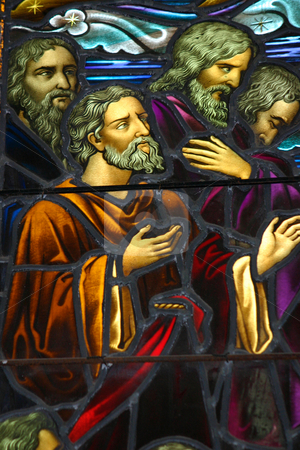 Stained glass window stock photo, Staned glass window depicting apostles.  circa 1870-1900.  Window shows some age. by Leah-Anne Thompson