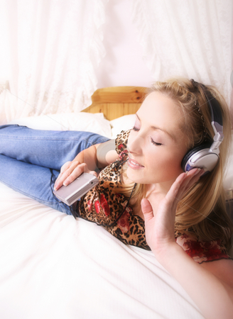 Relaxing to music at home stock photo, Relaxing to the sound of  music in the home by Leah-Anne Thompson