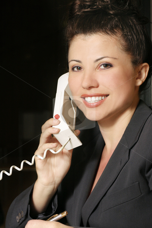 Business woman communicating by phone stock photo, Businesswoman on the phone by Leah-Anne Thompson