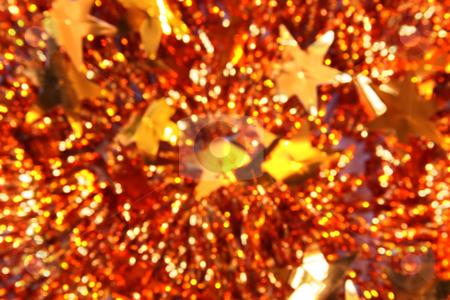 Abstract Christmas background of tinsel stock photo, Defocused Christmas background of tinsel with stars by Olga Lipatova