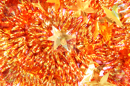 Christmas background of tinsel stock photo, Christmas background of tinsel with stars by Olga Lipatova