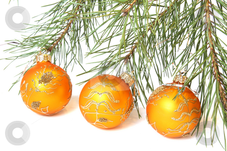 Christmas tree bauble stock photo, Christmas Tree and Three golden Christmas balls. Isolated on white by Olga Lipatova
