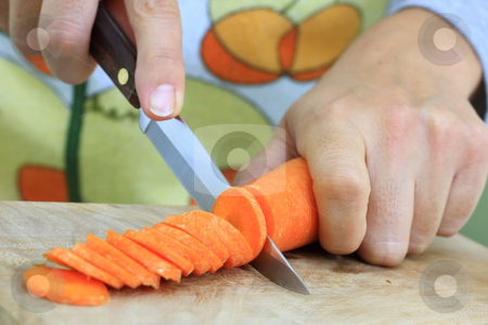 Carrot stock photo, To slice the vegetable sharp knife necessary by ARPAD RADOCZY