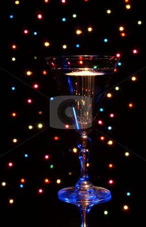 Champagne stock photo, Blue glass with champagne on background colorful lamp by Jolanta Dabrowska