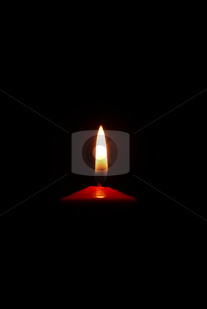 Candle stock photo, Lit red candle  on black background by Jolanta Dabrowska