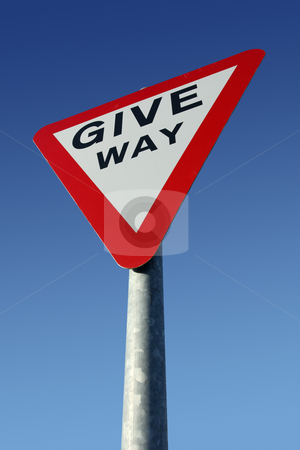 British give way road sign and a blue sky. stock photo, British give way road sign and a blue sky. by Stephen Rees