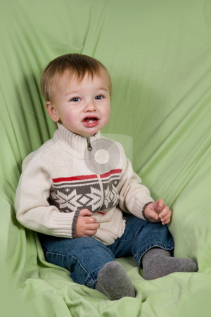 Toddler in Winter Clothes stock photo, A portrait of a cute toddler dressed in winter clothes. by Travis Manley