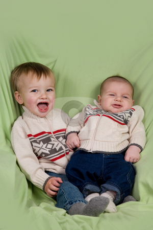 Baby Boys in Winter Clothes stock photo, A portrait of two baby boys (cousins) in winter clothes. by Travis Manley