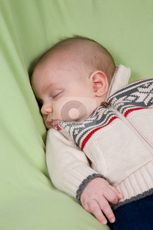 Sleeping Newborn stock photo, A portrait of a newborn baby boy sleeping in winter clothes. by Travis Manley