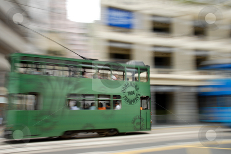 Two Trams stock photo, Two trams running toward each other in Hong Kong by ALEX CHOW