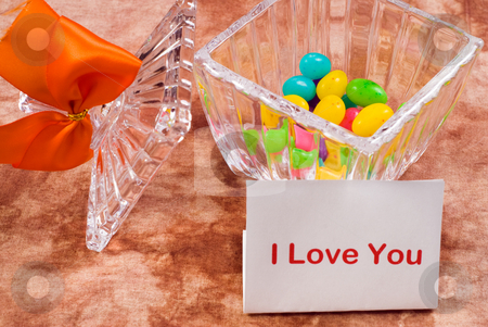 Love Note stock photo, A love note sitting beside a candy dish with a bow on it by Richard Nelson