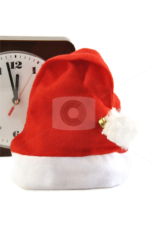 Some minutes before New Year.  stock photo, Santa red holiday hat and a watch  on white. by Liana Bukhtyyarova