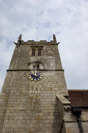 Clock tower stock photo, A stone tower of a rural english church with gilded clock by Mike Smith
