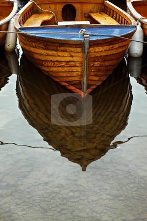 Boat Reflection stock photo, Reflection of small boat moored in shallow water by Robert Ford