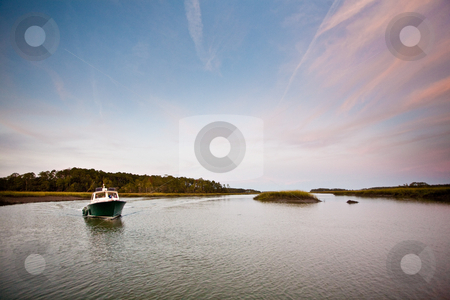 Boat on the water stock photo, Boat on a river at dusk by Johnny Griffin