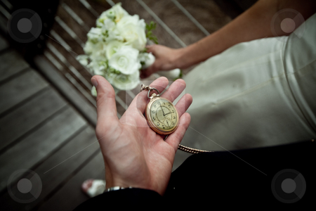 Pocket Watch stock photo, A man holds a pocket watch by Johnny Griffin