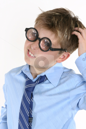 School student in comical spectacles and a confusedl expression stock photo, A boy scratching his head for an answer. by Leah-Anne Thompson