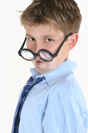 Child looking over top of round glasses stock photo, Child looking over the top of round glasses. by Leah-Anne Thompson