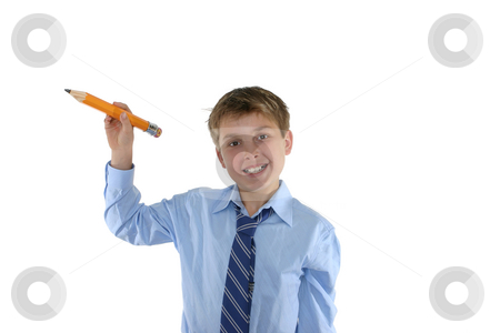 Smiling schoolboy holding a pencil stock photo, Happy schoolboy holding a pencil in a writing position by Leah-Anne Thompson