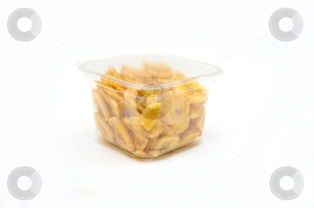 Dried Banana Chips stock photo, Sliced and dried bananas in a clear airtight plastic container on a white background by Lynn Bendickson