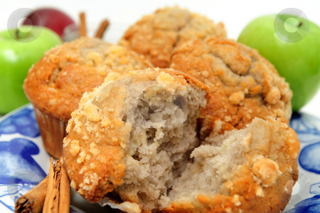 Apple Spice Muffin stock photo, Muffins made with green apples and cinnamon served on a blue and white plate. by Lynn Bendickson