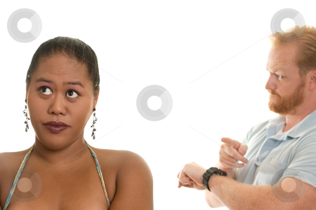 Running Late stock photo, A man indicates the time.  Woman in the foreground, focus on woman. by Leah-Anne Thompson