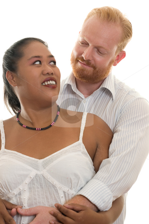 Lovers in arms stock photo, Diversity lovers embrace and look into each other's eyes. by Leah-Anne Thompson