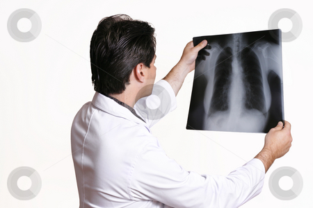 Doctor Holding X-ray stock photo, A doctor examining an x-ray by Leah-Anne Thompson
