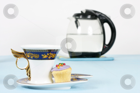 Coffee Break stock photo, A cup of coffee or tea and a mini cupcake.    Kettle in background out of focus. by Leah-Anne Thompson