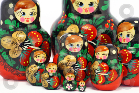 Bright wooden dolls stock photo, Multi-coloured bright wooden Russian children's toys of a doll. by Aleksandr Volokov