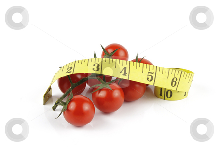 Tomatoes and Tape Measure stock photo, Small red ripe tomatoes on the vine with yellow tape streamer on a reflective white background by Keith Wilson