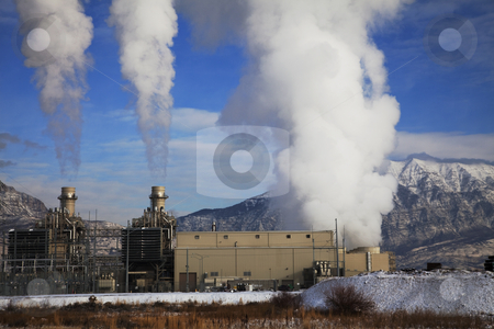 Power Plant stock photo, Power pland emitting smoke with blue sky's amd mountains in the background by Mark Smith