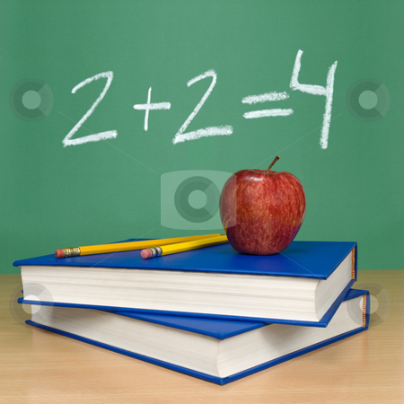 Basic sum stock photo, 2 + 2 = 4 written on a chalkboard. Books, pencils and an apple on the foreground. by Ignacio Gonzalez Prado