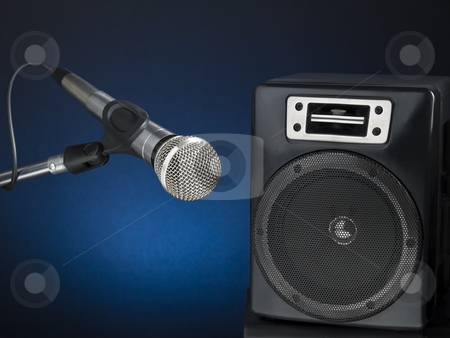 Let's rock! stock photo, Professional microphone and speaker over a diffuse blue background. by Ignacio Gonzalez Prado