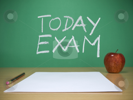 Today exam stock photo, Blank sheets, a pencil and an apple over the desk. Today exam is written on the chalkboard as a background. by Ignacio Gonzalez Prado