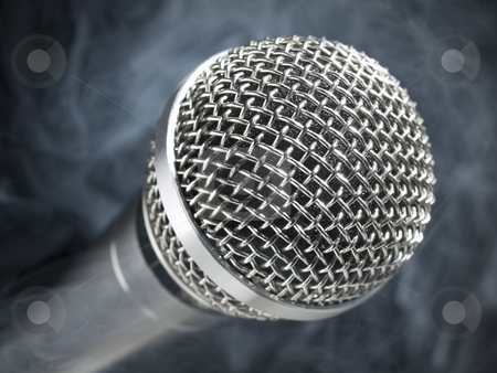 Microphone on stage stock photo, A dynamic microphone on stage. by Ignacio Gonzalez Prado